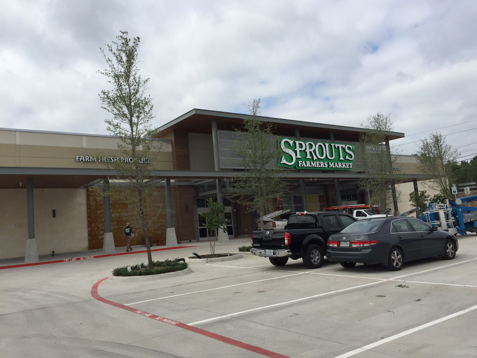 The shopping center at Lake Highlands Town Center includes a Sprouts grocery store at the southeast corner of Skillman and Walnut Hill.