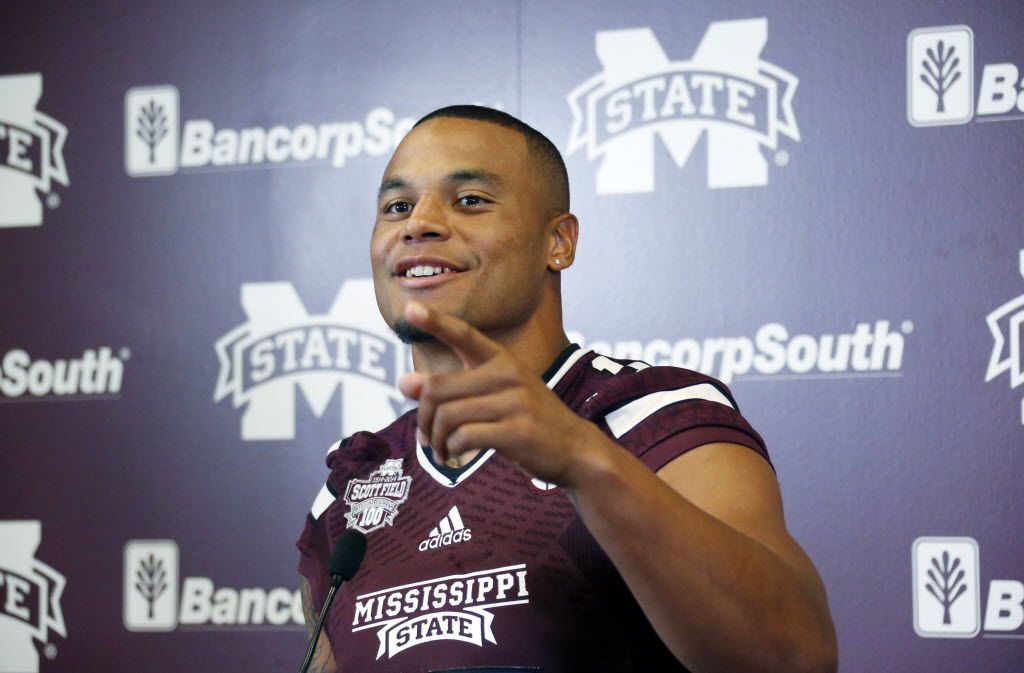 Mississippi State quarterback Dak Prescott smiles at a question from reporters about the upcoming season during NCAA college football media day, Friday, Aug. 7, 2015, in Starkville, Miss. (AP Photo/Rogelio V. Solis) ORG XMIT: MSRS118