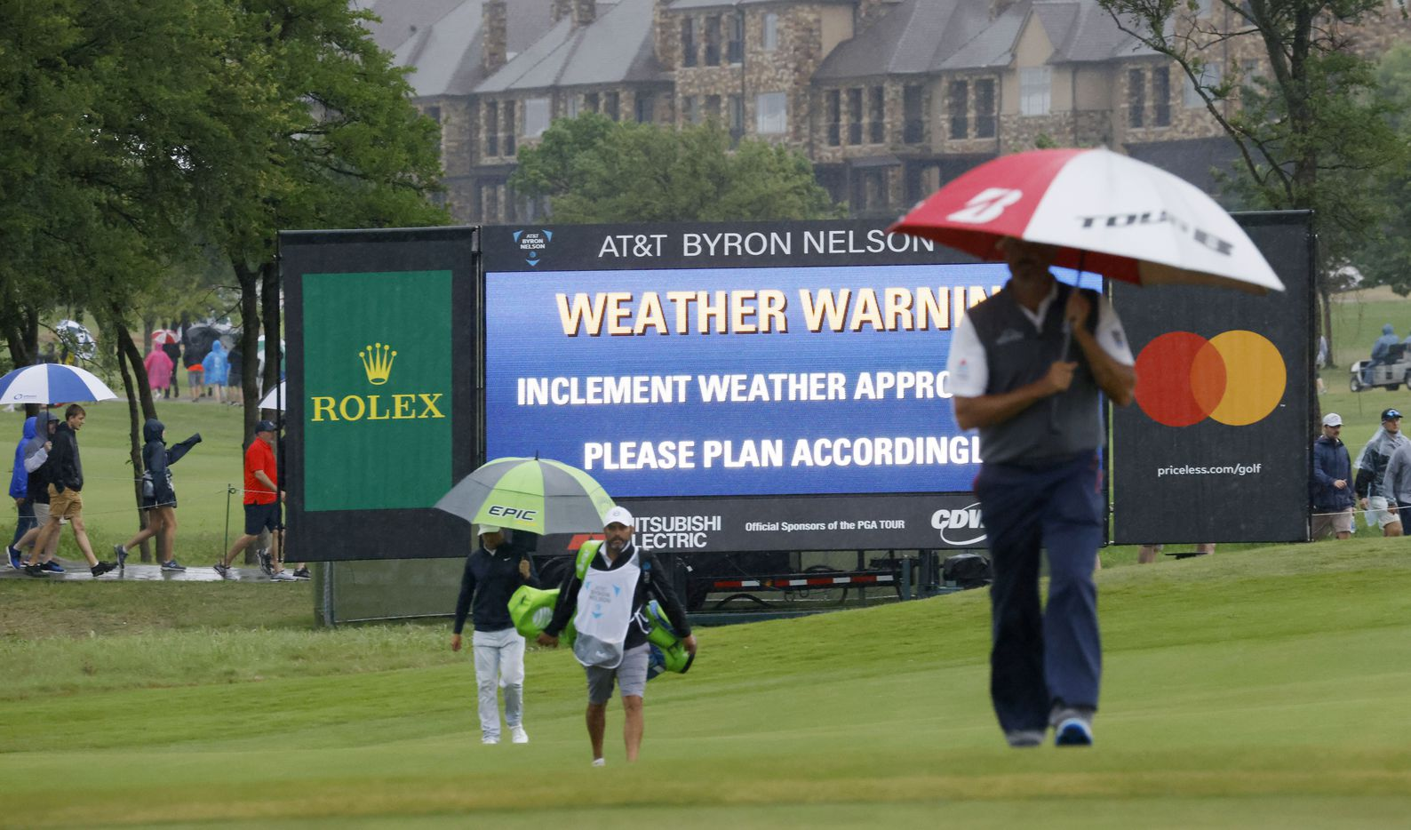 Matt Kuchar walks up to the green in the rain on the 9th hole during round 4 of the AT&T Byron Nelson  at TPC Craig Ranch on Saturday, May 16, 2021 in McKinney, Texas. (Vernon Bryant/The Dallas Morning News)