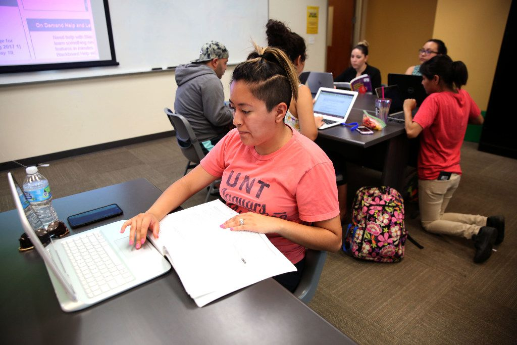 Karina Escalante, a student in UNT Dallas' School of Education, works on a group project during an educational leadership class at the campus in Dallas on Monday.