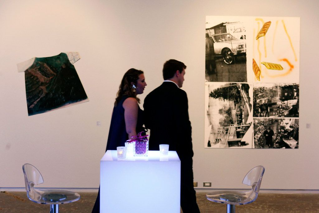 Kelle Knight and Chris Lussier, walk between an oil on aluminum painting titled Shirt, by Keer Tanchak, left, and a silkscreen and spray paint on PVC foam board titled, Out of Nowhere, by Leo Gabin, right, during the MTV Re:Define gala at the Dallas Contemporary, Friday evening, March 24, 2017 in Dallas. Ben Torres/Special Contributor