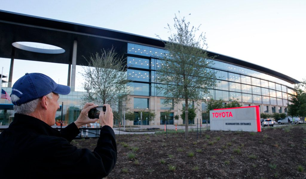Toyota's Mike Wells, group vice president, Americas region stops by the front entrance to take a photo of the new Toyota North American headquarters in Plano on Monday, May 15, 2017. (Vernon Bryant/The Dallas Morning News)