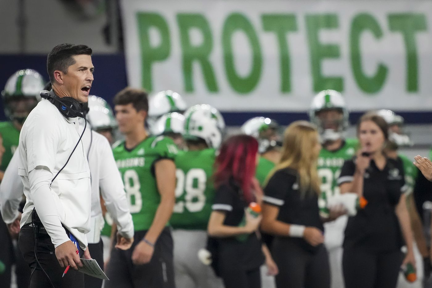 Southlake Carroll head coach Riley Dodge works on the sidelines during the first half of a high school football game against Highland Park at AT&T Stadium on Thursday, Aug. 26, 2021, in Arlington.