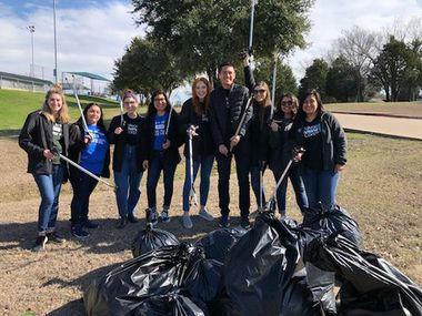A group of volunteers show off their trash haul at a previous Trash Bash in Mesquite. This year's event takes place Saturday.