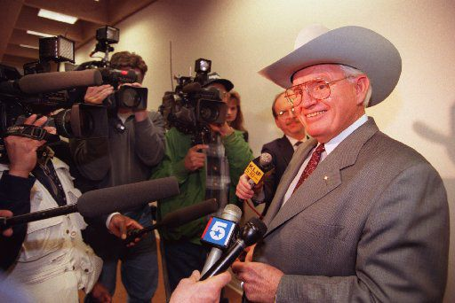 Dallas Mavericks owner Donald  Carter talks with media members after a 1995 meeting with Dallas City  representatives Thursday morning about building a new arena  downtown. The group members were getting reacquainted after the  sale of Dallas Stars.