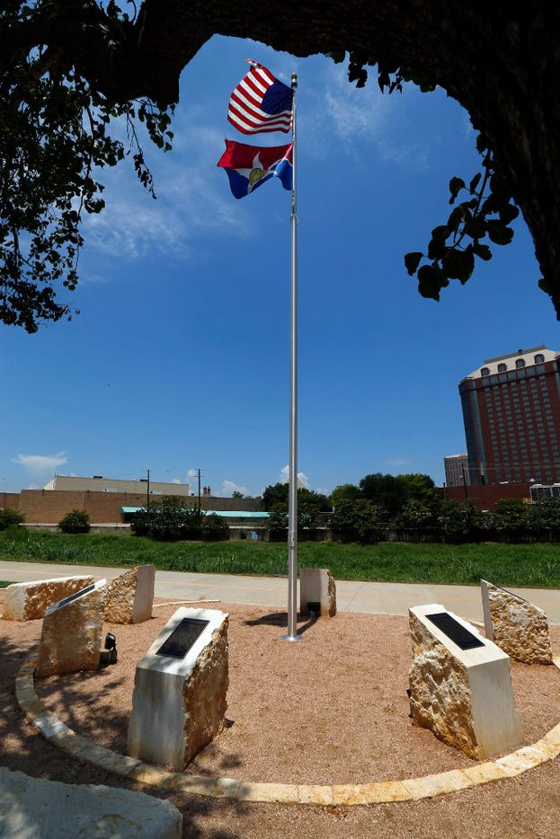 The Circle of Heroes memorial was unveiled Thursday, July 6, 2017 on Manufacturing Street in the Design District area of Dallas. Adorned with inscriptions of their lives, the five stones represent the Dallas and DART officers killed during an ambush last July 7. The U.S. and city of Dallas flags fly from a pole erected inside the circle.