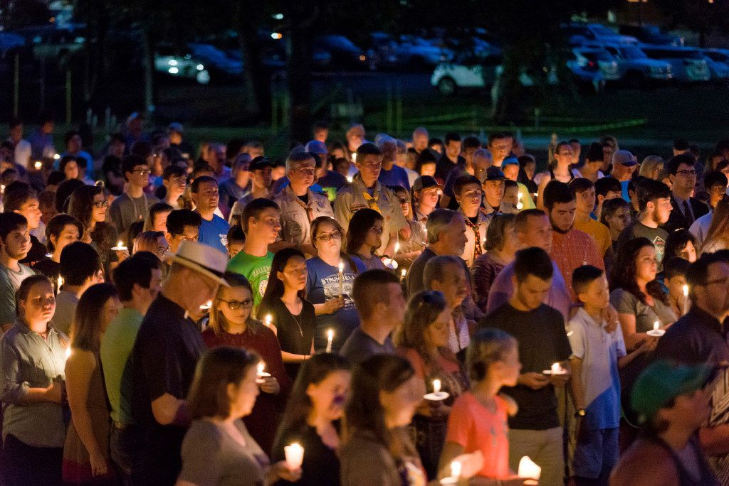 Hundreds from Hallsville, Texas, and surrounding communities gather for a candlelight vigil Sunday, August 6, 2017, after two Hallsville Boy Scouts were killed and another severely injured in a Saturday boating accident.