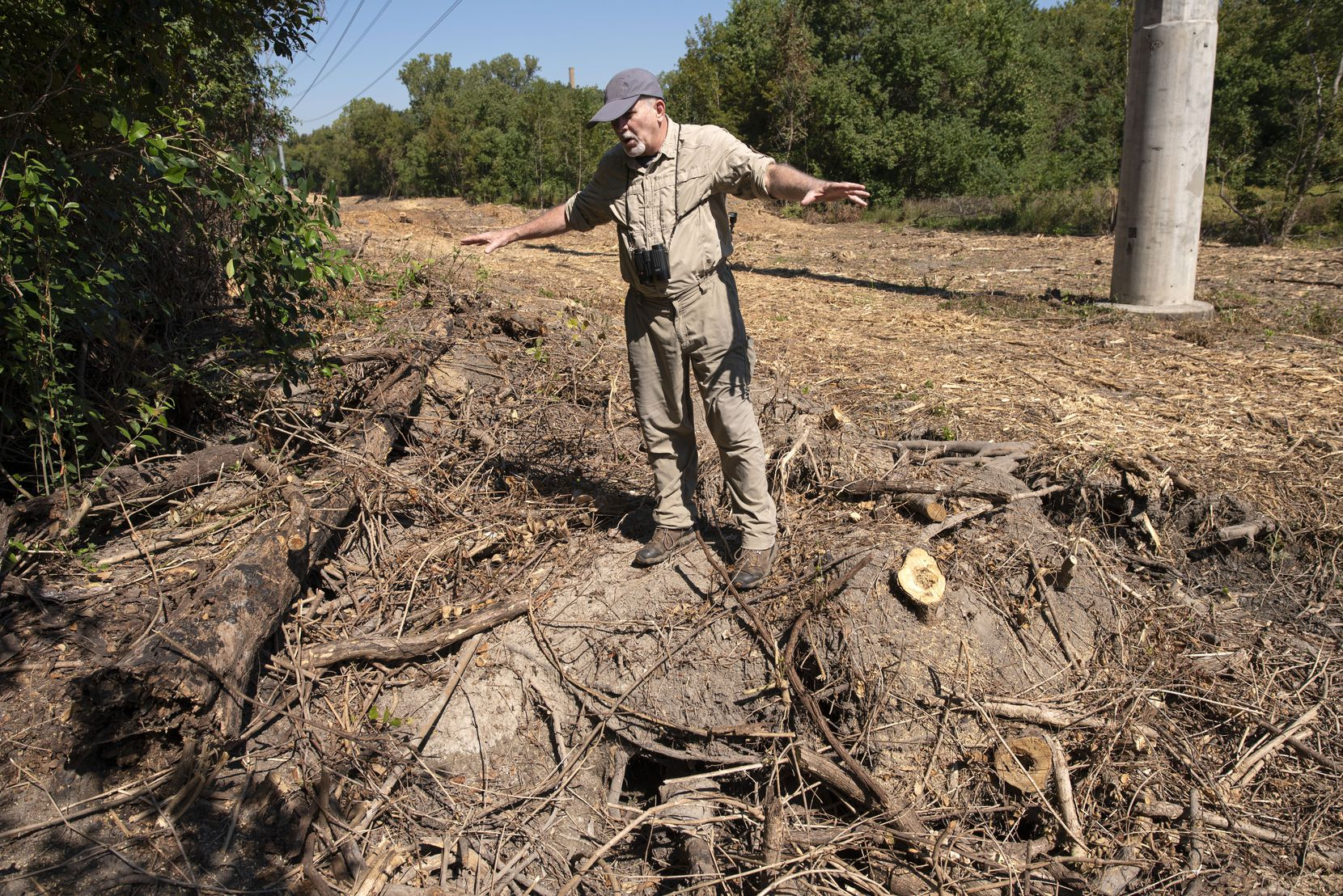Environmental activist Kelly Cotten shows where an Oncor contractor destroyed a beaver dam in the Old Fish Hatchery Nature Area while clearing out vegetation.