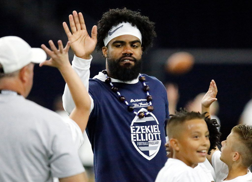 Ezekiel Elliott high fives campers after a drill at The Albertsons and Tom Thumb Ezekiel Elliott Football ProCamp held at the Ford Center at The Star in Frisco on Sunday, May 19, 2019.  (Stewart F. House/Special Contributor)