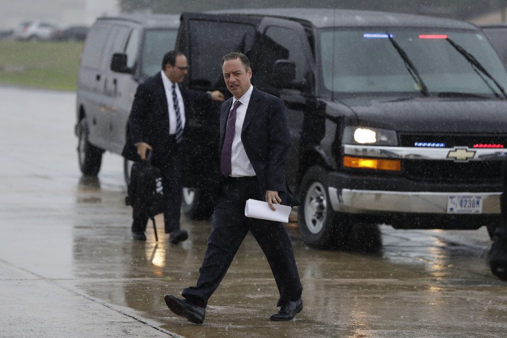 Former White House Chief of Staff Reince Priebus walks to board Air Force One at Andrews Air Force Base, Md., to travel with President Donald Trump to Brentwood, N.Y., for a speech to law enforcement officials on the gang MS-13.