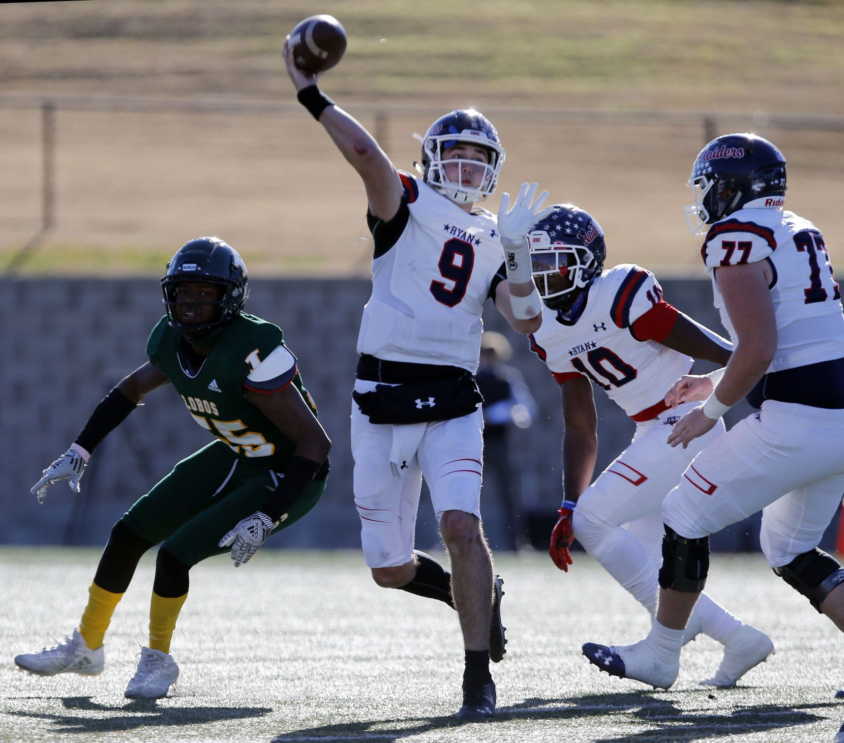 Denton Ryan QB Seth Hennigan (9) throws a pass under pressure during the first half of a Class 5A Division I Region I semifinal football playoff game against Longview High at Mesquite Memorial  Stadium in Mesquite on Saturday, December 26, 2020. (John F. Rhodes / Special Contributor)
