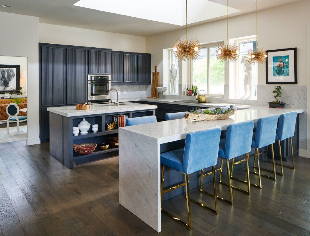 Adding stools in your kitchen is an easy way to accommodate guests who are sure to gather there during parties, the team at Dallas' Scout Design Studio says. (Scout Design Studio)
