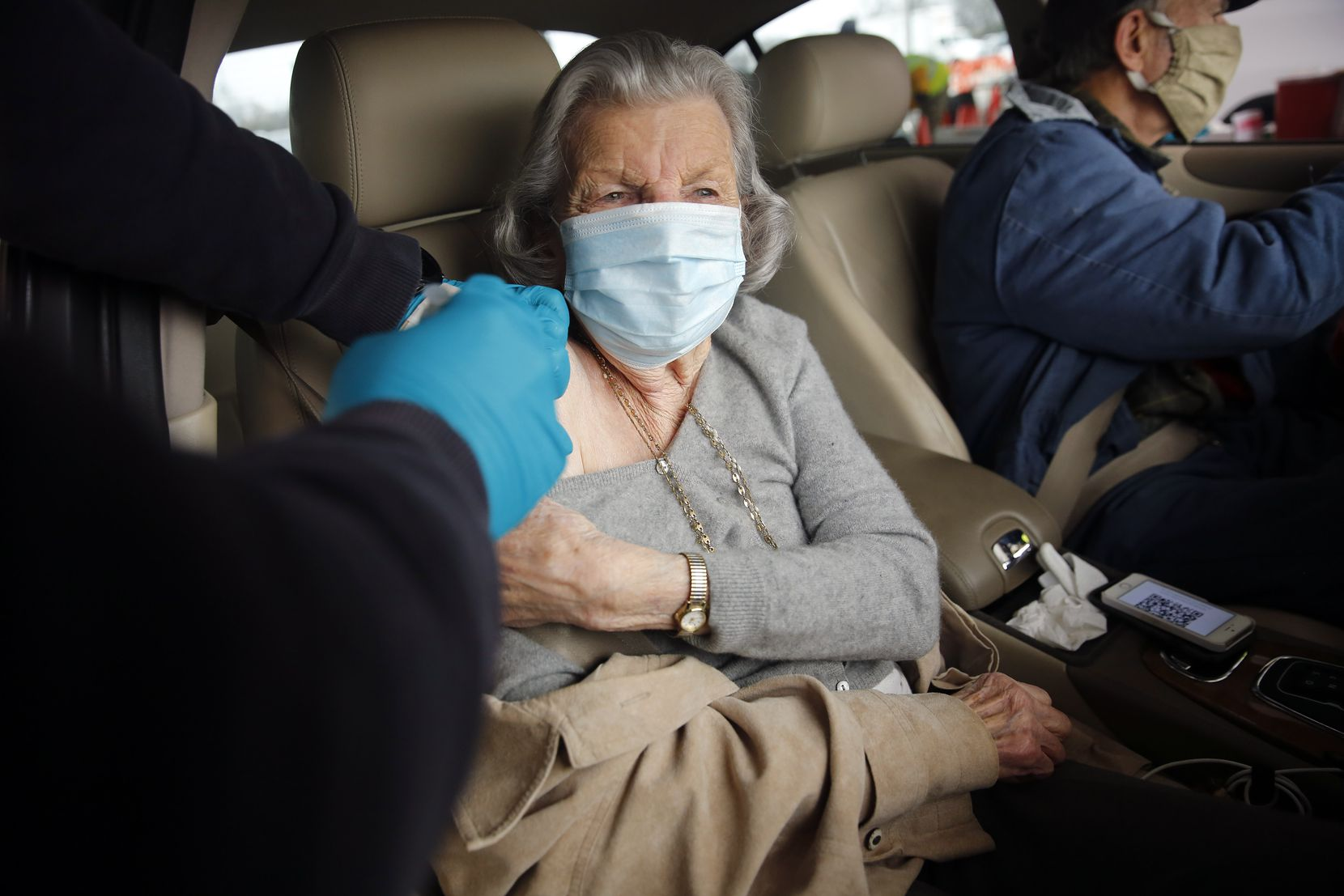 Ethel Radovich of Dallas received her second COVID-19 vaccination shot in a drive-thru lane at Fair Park in Dallas, Wednesday, February 10, 2021. (Tom Fox/The Dallas Morning News)