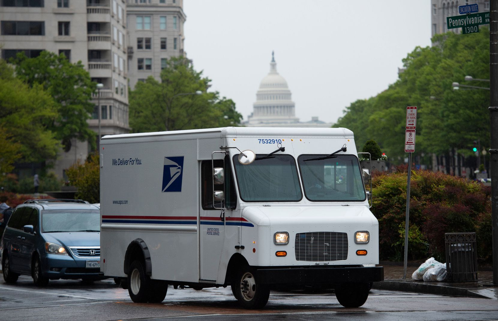 A U.S. Postal Service truck drives down Pennsylvania Avenue in Washington, D.C. on April 23.