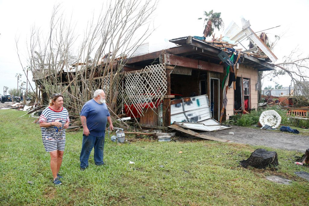 Bill and Paulette Rogers looks at the damage to their house after Hurricane Harvey destroyed their house in Port Aransas, Texas on Aug. 26, 2017.   (Nathan Hunsinger/The Dallas Morning News)