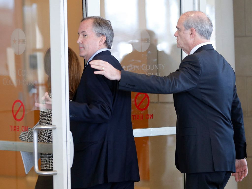 Texas Attorney General Ken Paxton (left) and his attorney Phillip Hilder enter the Collin County Courthouse for his pretrial hearing in McKinney on Feb. 16, 2017. (Jae S. Lee/The Dallas Morning News)