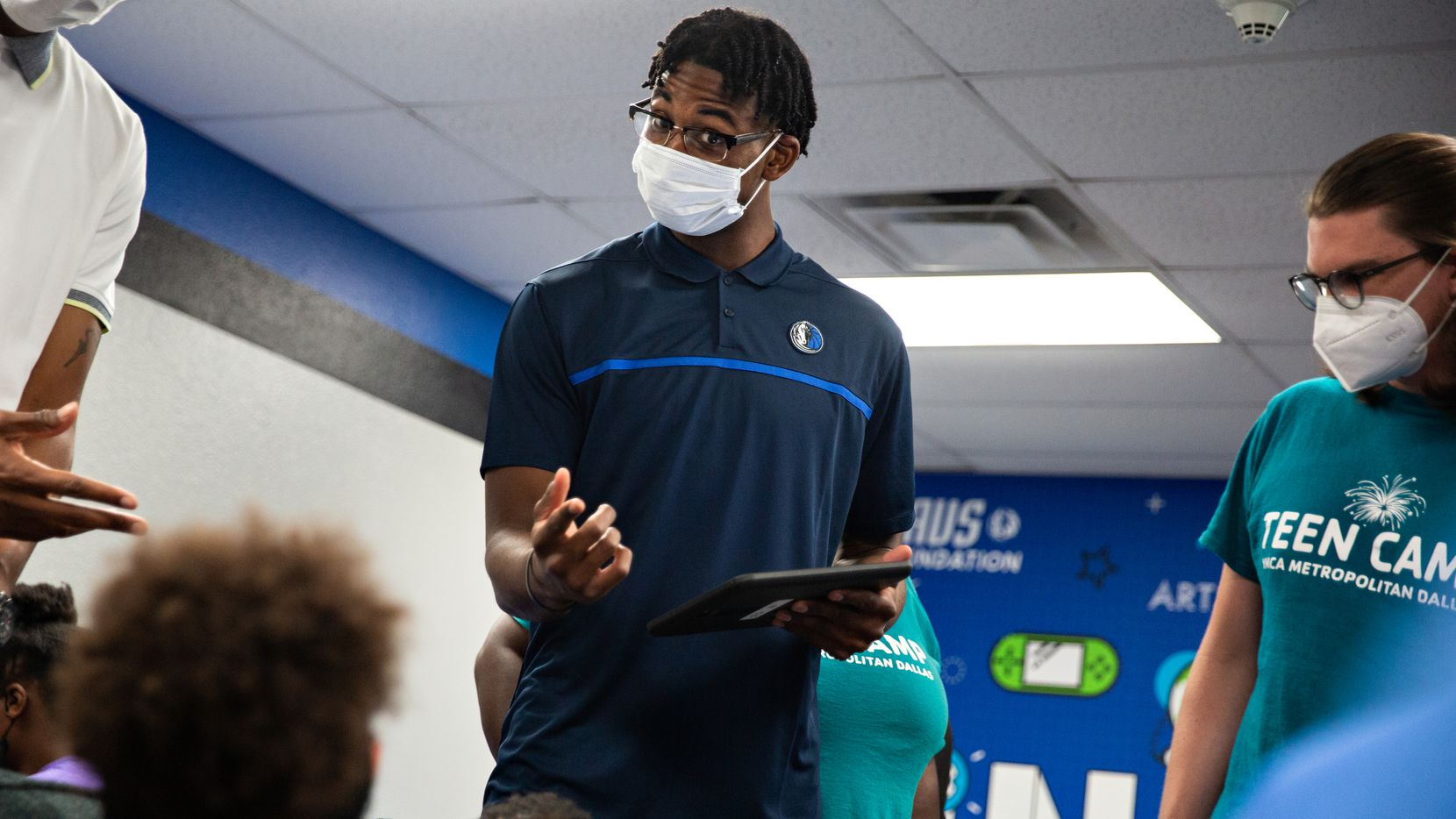 Dallas Mavericks guard Nate Hinton talks to YMCA Teen Camp kids at the Mavs Foundation's unveiling of its newest reading and learning center renovation at the Moorland YMCA at Oak Cliff on August 3, 2021.