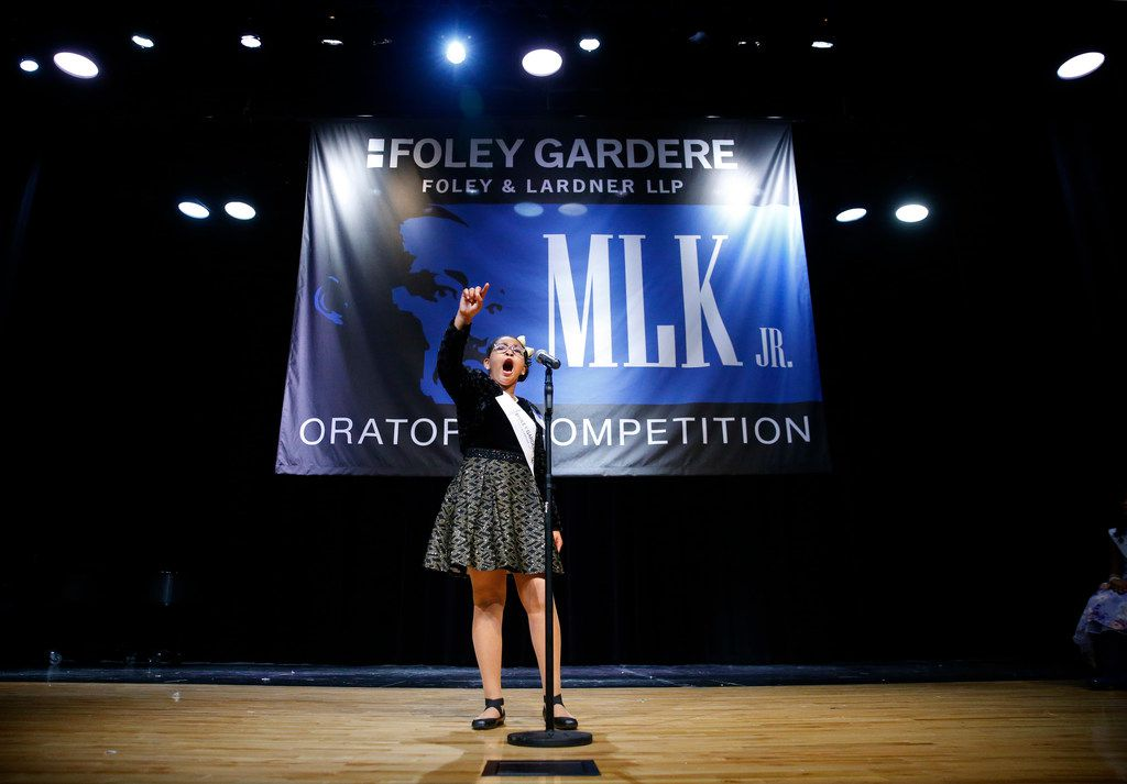 Layla James, a fifth-grader at Ronald E. McNair Elementary School, delivers her speech before an audience at Adamson High School in Dallas.