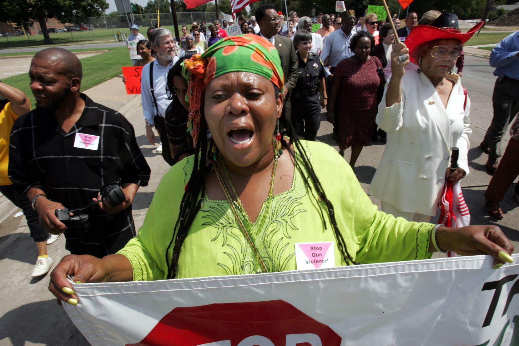 In this August 2007 file photo, Afiah Bey — formerly known as Melody Bell — participates in a March Against Guns in Dallas, months after losing her son Ishmael Mozeke to gun violence.