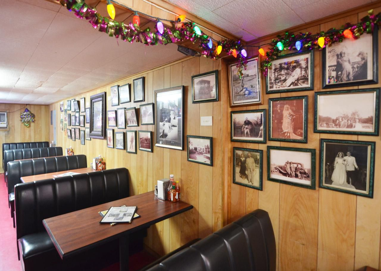 The walls at  family-owned Sonny's Place in Galveston are covered with photographic memories. Lawrence Puccetti Jr. is owner of the hopping, home-style restaurant.