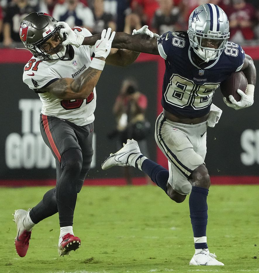 Dallas Cowboys wide receiver CeeDee Lamb (88) pushes past Tampa Bay Buccaneers safety Antoine Winfield Jr. (31) to pick up a first down on a 3rd-and-11 play in the final two minutes of the second half of an NFL football game at Raymond James Stadium on Thursday, Sept. 9, 2021, in Tampa, Fla. The  Buccaneers won the game 31-29. (Smiley N. Pool/The Dallas Morning News)