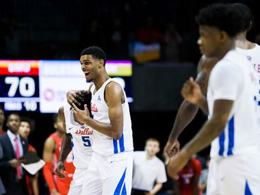 Southern Methodist Mustangs guard Emmanuel Bandoumel (5) gets a hug from forward Feron Hunt (1) after a three pointer in overtime of a basketball game between SMU and University of Houston on Saturday, February 15, 2020 at Moody Coliseum in Dallas. (Ashley Landis/The Dallas Morning News)