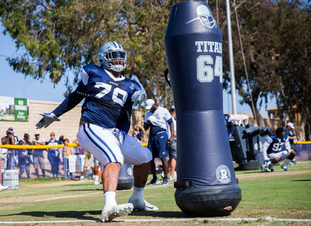 Dallas Cowboys defensive tackle Trysten Hill (79) attacks a dummy during an afternoon practice at training camp in Oxnard, California on Monday, August 12, 2019.