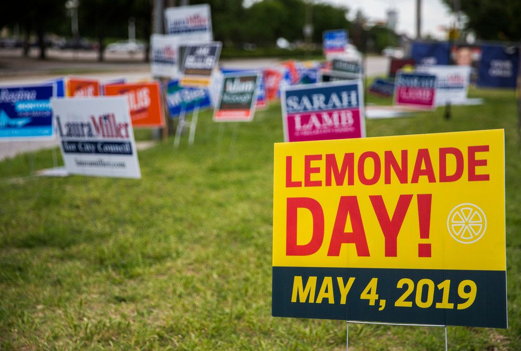 Although unrelated to the election -- aside from election day and Lemonade Day both being on May 4, 2019 -- a sign for Lemonade Day is displayed among campaign signs near Our Redeemer Lutheran Church, an early voting polling place, on Monday, April 29, 2019 in Dallas.