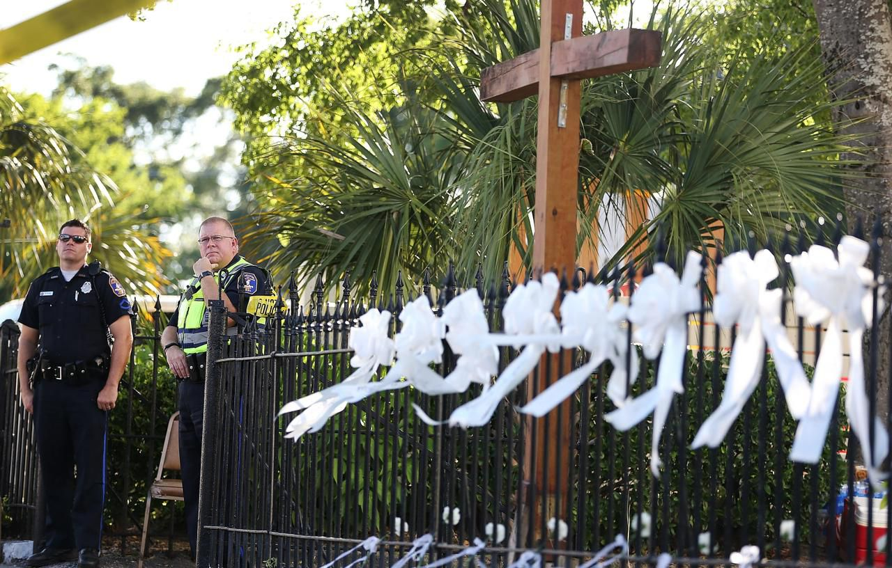 Charleston, S.C., police officers stood outside the church where a gunman killed nine parishioners in June. The massacre ultimately convinced Vester Flanagan II, the killer in this week's Virginia shootings, that his aspirations were hopeless. Flanagan was reported to be frustrated with his patchy career as a TV news reporter.