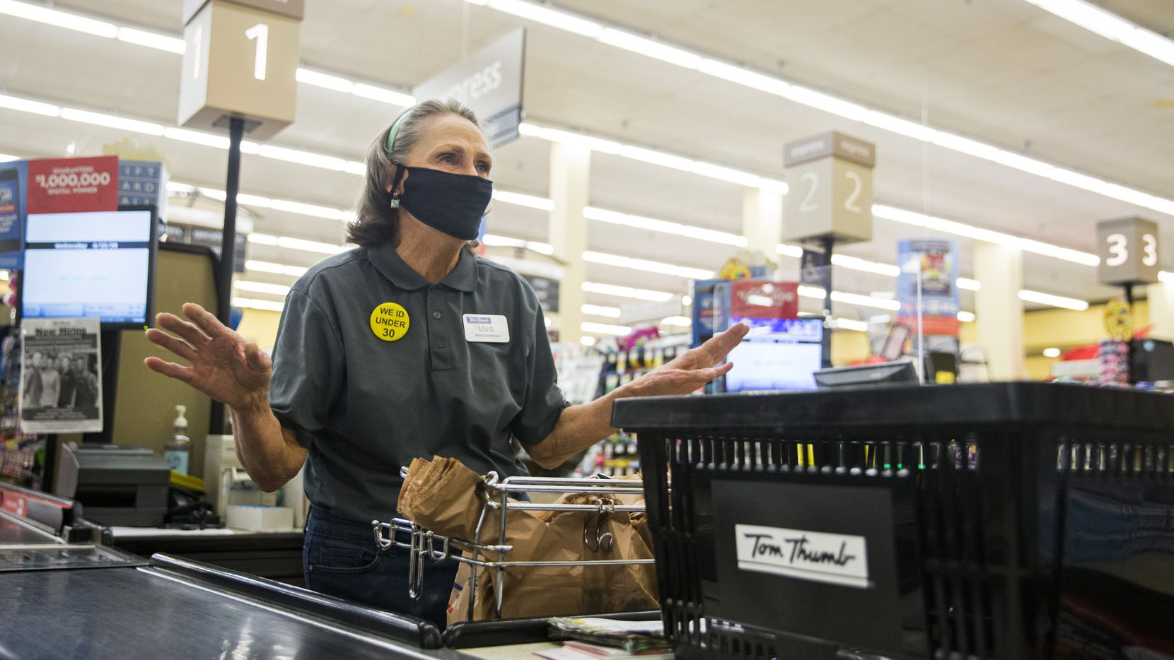 "Lou Dalton on the job last Wednesday as a checkout clerk at the Arapaho Village Tom Thumb grocery store in Richardson. ""I love my customers,"" she said. ""That's why I am excited to come to work every day."""