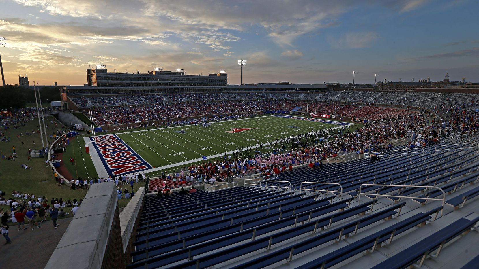 People watch the kick-off of the SMU and UCF game at Gerald J. Ford Stadium on Saturday, Nov. 4, 2017, in Dallas. SMU has had poor attendance in recent games.