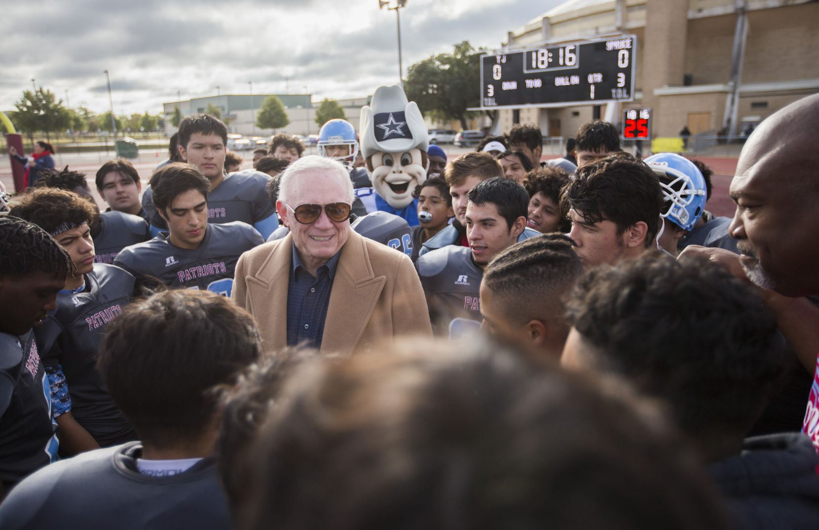 Dallas Cowboys Owner Jerry Jones talked with players before Thomas Jefferson High School took on Sprite High School on Saturday, October 26, 2019 at Loos Stadium in Dallas. Jones presented a check for $1 million to DISD before the game. Jefferson High School is one of the DISD schools hit the hardest in last weekend's tornado. (Ashley Landis/The Dallas Morning News)