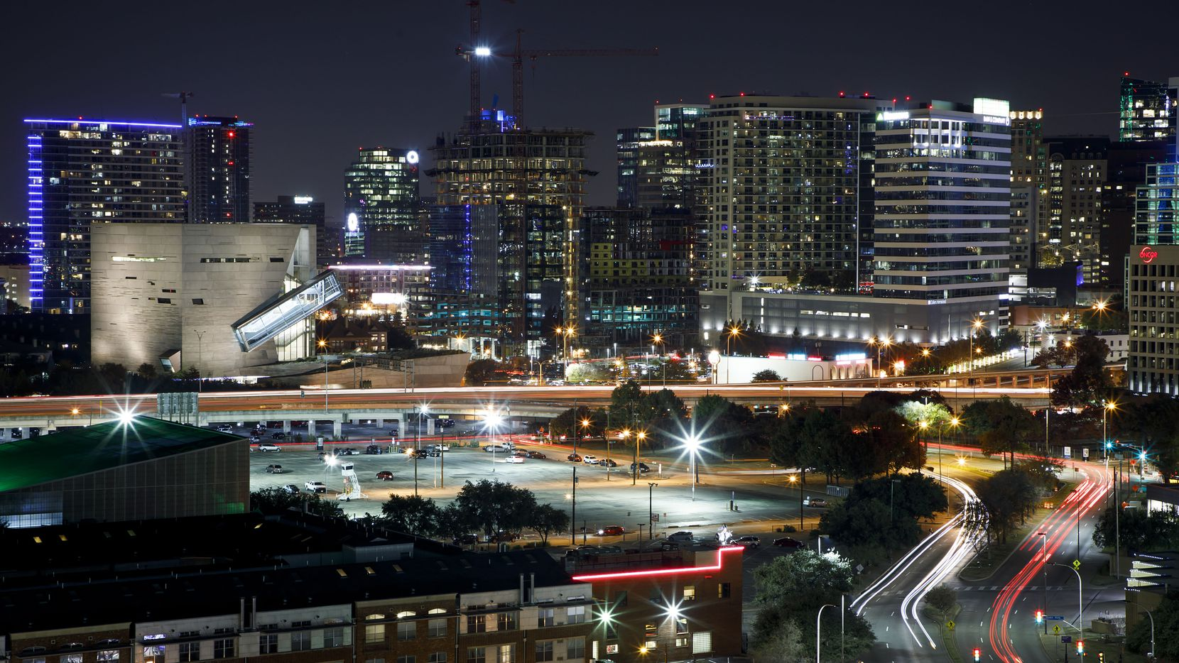 A nighttime view of Uptown (at right) and the Perot Museum (left) in Dallas on Saturday, Dec. 2, 2017. (Smiley N. Pool/The Dallas Morning News)
