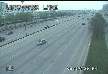 Traffic zipped by Park Lane in Dallas on North Central Expressway on Tuesday evening.