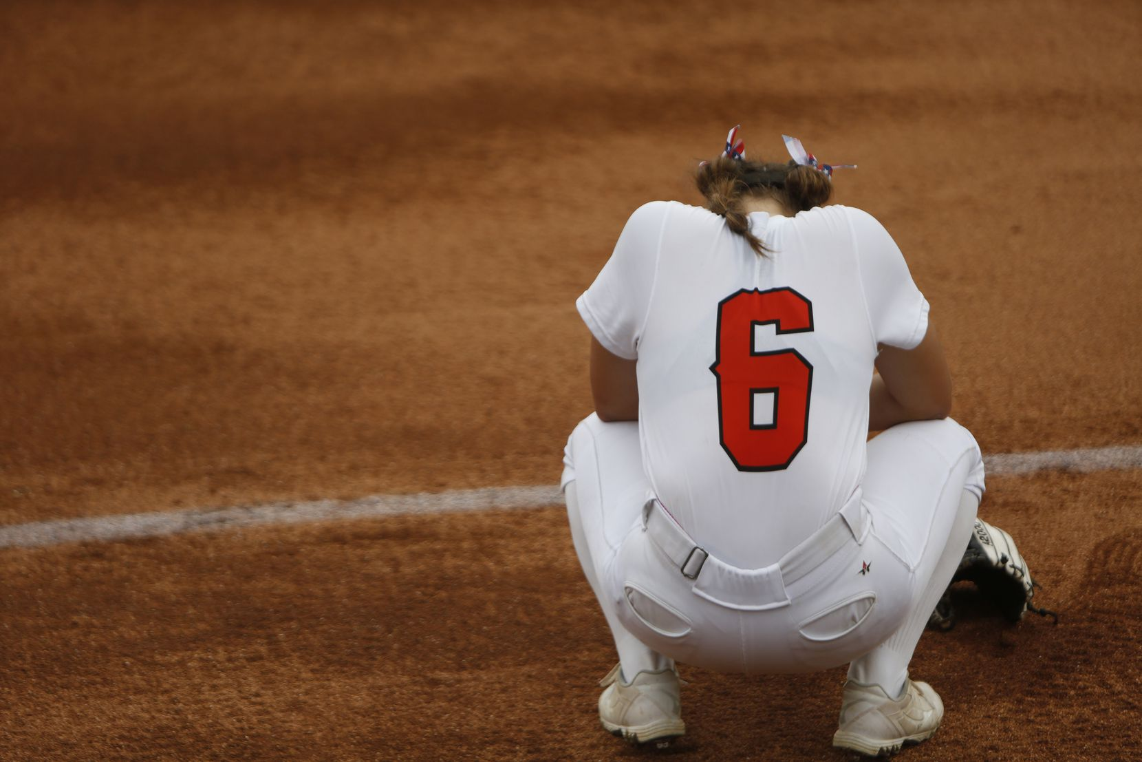 Aledo's Caitlin Beaty (6) pauses near 1st base before the start of their state championship game against Barbers Hill. The two teams played their UIL 5A state softball championship game at Red and Charline McCombs Field on the University of Texas campus in Austin on June 5, 2021. (Steve Hamm/ Special Contributor)
