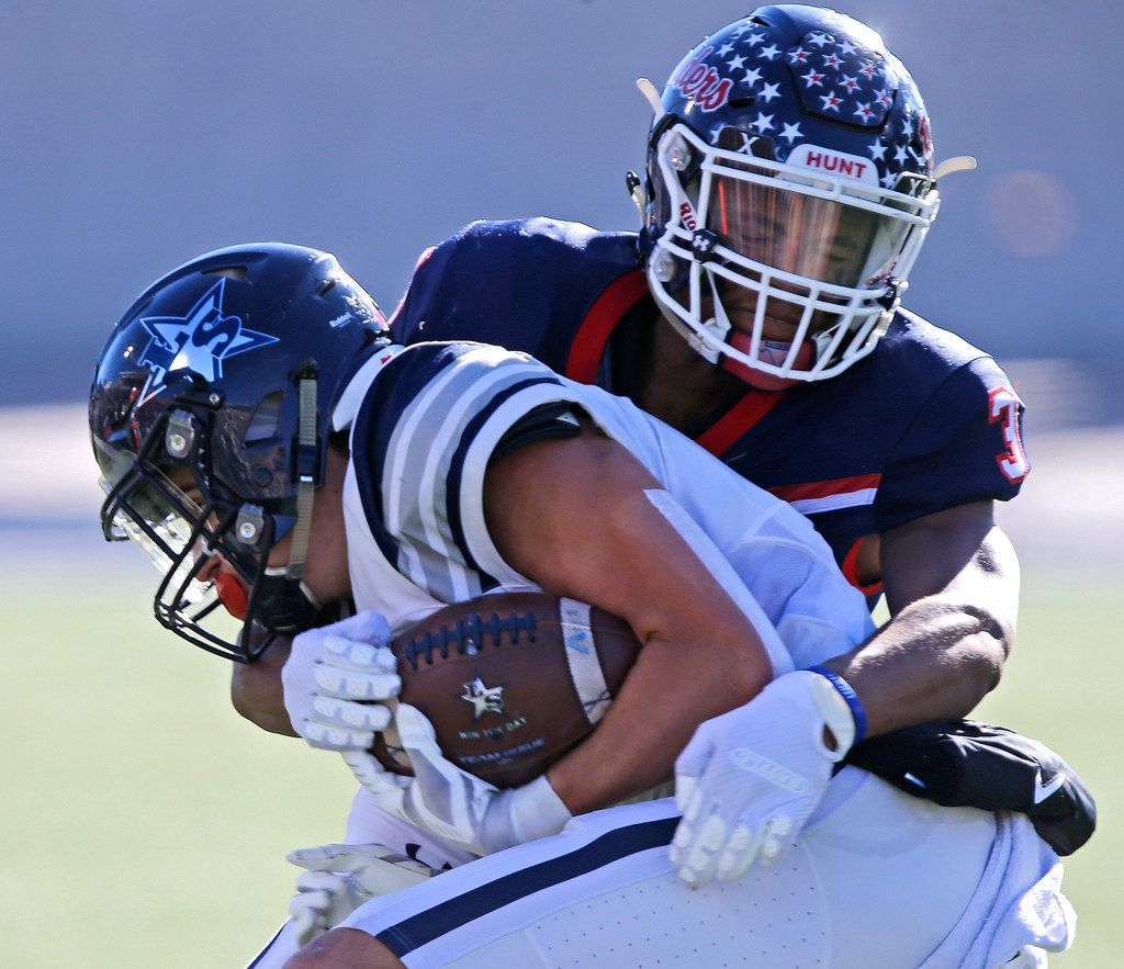 Lone Star High School wide receiver Trace Bruckler (4) is tackled by Denton Ryan High School defensive back Austin Jordan (3) during the first half as Frisco Lone Star High School played Denton Ryan High School in a Class 5A Division I state semifinal game at Eagle Stadium in Allen on Saturday, December 14, 2019.