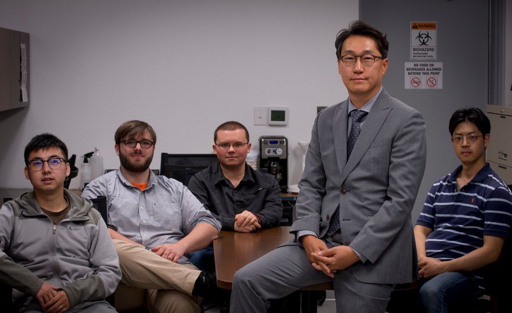Minjun Kim, professor and Robert C. Womack chair in Engineering, poses with his team of graduate students at SMU in Dallas on May 18. Grad students are, from left, Xiao Zhang, Samuel Sheckman, Louis W. Rogowski and Jung Soo Lee.
