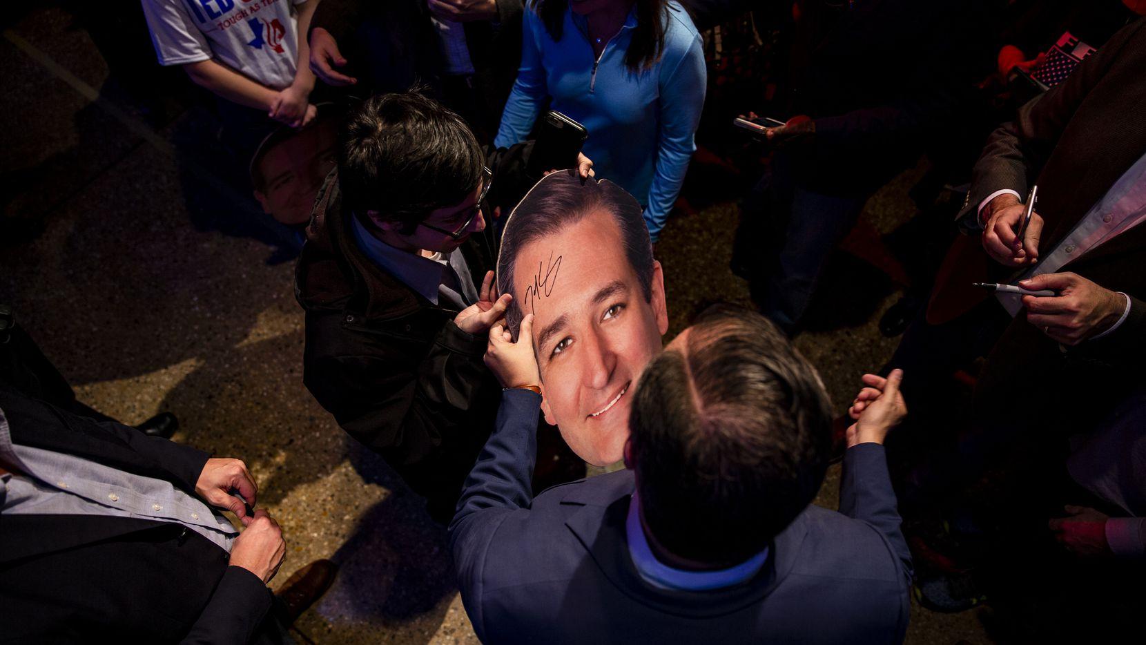 Senator Ted Cruz signs a cutout of his head following a campaign rally at Cendera Center in Ft. Worth on Friday, November 2, 2018. (Shaban Athuman/The Dallas Morning News)