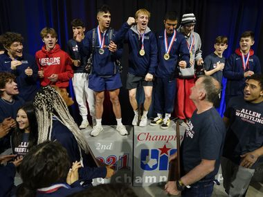 Braxton Brown of Allen (top center) leads the combined boys and girls teams in celebration  atop the awards stand after capturing his fourth state title while both the boys and girls teams won the team titles during the UIL State Wrestling tournament at the Berry Center on Saturday, April 24, 2021, in Cypress, Texas.