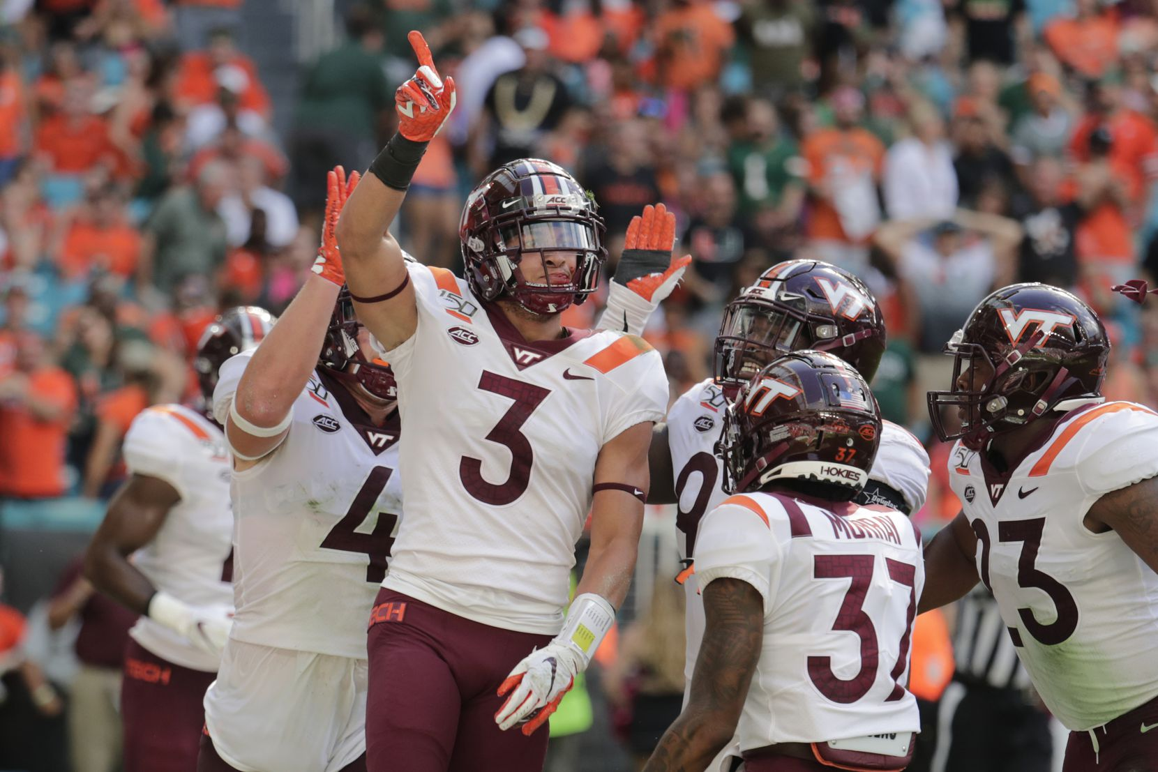 In this Oct. 5, 2019, file photo, Virginia Tech defensive back Caleb Farley (3) celebrates after intercepting a pass during the first half of the team's NCAA college football game against Miami in Miami Gardens, Fla.