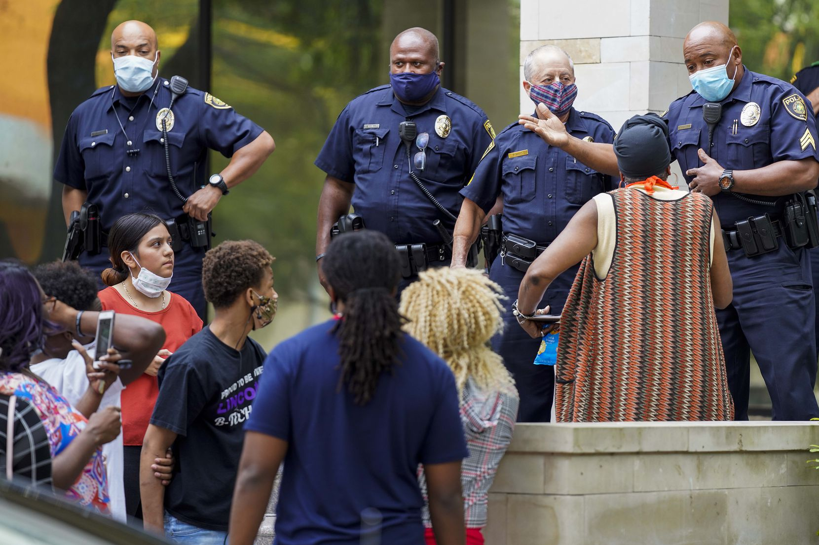 A Dallas ISD police officer asked  protesters to leave after activist Carlos Quintanilla tried to lead students, parents and community organizers into the DISD administration building Tuesday.
