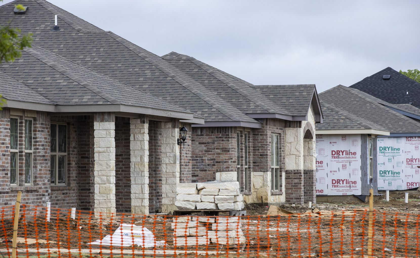 Construction was underway last month on houses in Kensington Valley by Camden Homes in southeast Dallas. The community is near the intersection of Interstates 635 and 20 and has 112 homes.