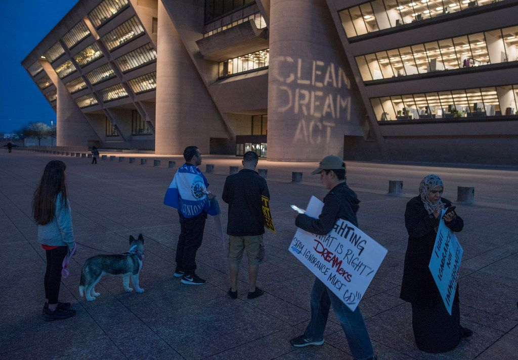 """A slogan reading """"Clean Dream Act"""" is projected on Dallas City Hall during a DACA protest Monday, March 5, 2018."""