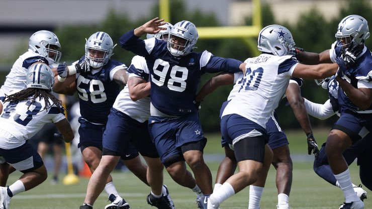 Dallas Cowboys rookie defensive tackle Quinton Bohanna (98) gets through the offensive line during team drills at rookie minicamp at The Star in Frisco, Texas, Saturday, May 15, 2021.