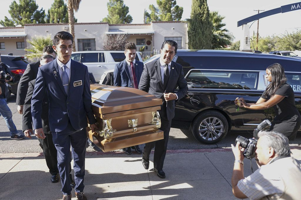 Pallbearers carry Margie Reckard's casket into a public memorial.