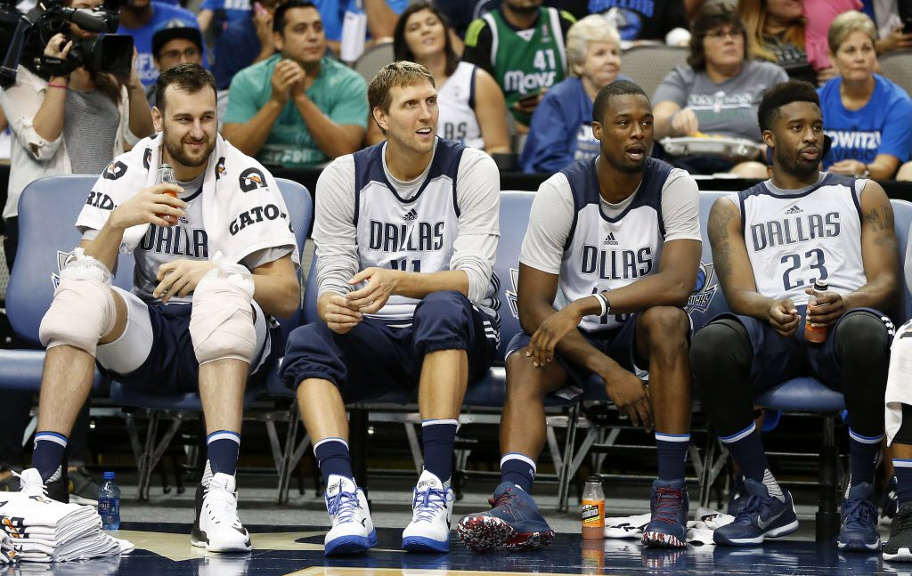 L to R, Mavericks center Andrew Bogut (6), forward Dirk Nowitzki (41),  forward Harrison Barnes (40) and guard Wesley Matthews (23) sit on the bench during open practice at American Airlines Center in Dallas, Wednesday, Sept. 28, 2016. (Jae S. Lee/The Dallas Morning News)
