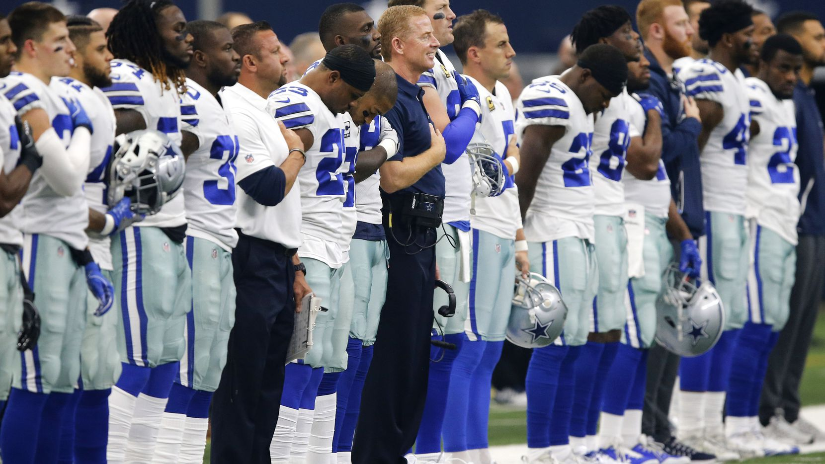 Dallas Cowboys players and coaches stand along the sideline for the national anthem before the Los Angeles Rams game at AT&T Stadium in Arlington, Texas, Sunday, October 1, 2017. Players from both teams stood for the anthem. (Tom Fox/The Dallas Morning News)