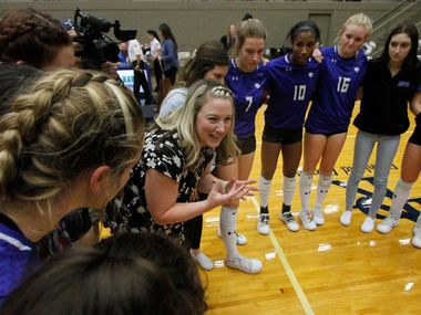 Trophy Club Byron Nelson head volleyball coach Brianne Barker-Groth is unable to contain her excitement as she shares words of encouragement to her Lady Bobcats players after they defeated Denton Guyer in straight sets to advance to the state tournament. The two teams played their Class 6A Region l championship volleyball match at W.G. Thomas Coliseum in Haltom City on November 16, 2019.