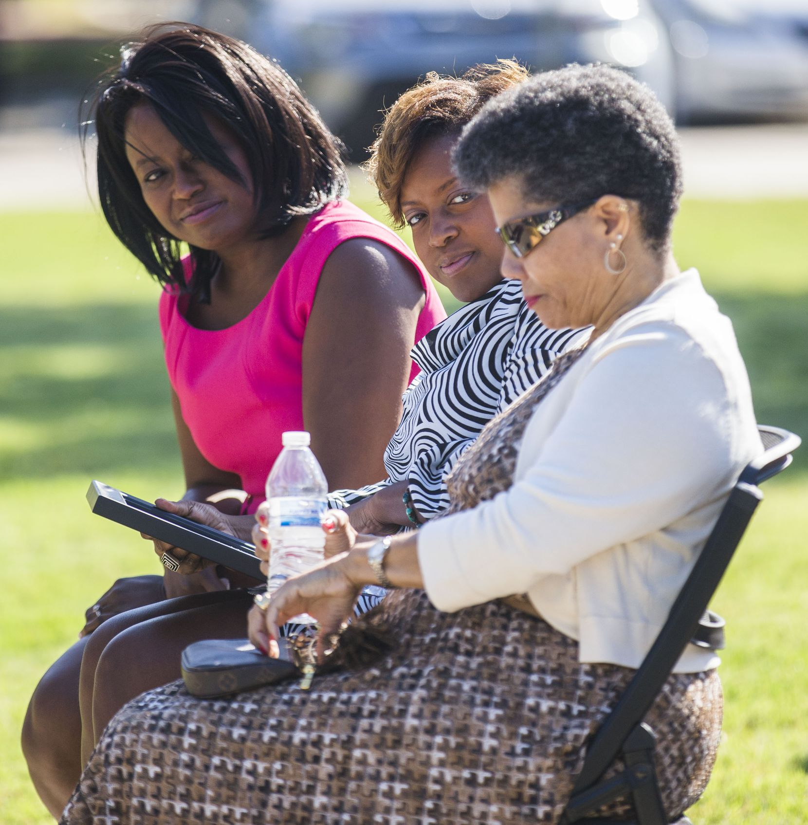 Dr. Carla Spann Lopez, left, and Gai Spann look at their mother, Gwenelle Johnson Spann, right, during funeral services for her husband, retired Army Air Corps 1st Lieutenant Calvin Spann on Saturday, September 12, 2015 at Covenant Church in Carrollton, Texas.  Spann was an original Tuskegee Airman and fighter pilot with the 100th Fighter Squadron of the 332nd Fighter Group.  He served during World War II, when he flew 26 combat missions.   (Ashley Landis/The Dallas Morning News)