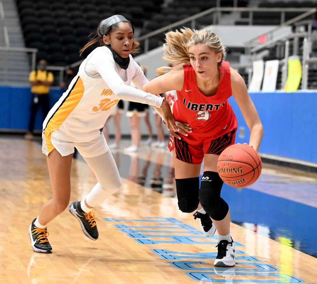 Liberty's Lily Ziemkiewicz drives on Memorial's Cammie McKinney in the second half of a Class 5A girls high school playoff basketball game between Frisco Memorial and Frisco Liberty, Wednesday, Feb. 24, 2021, in Frisco, Texas. (Matt Strasen/Special Contributor)